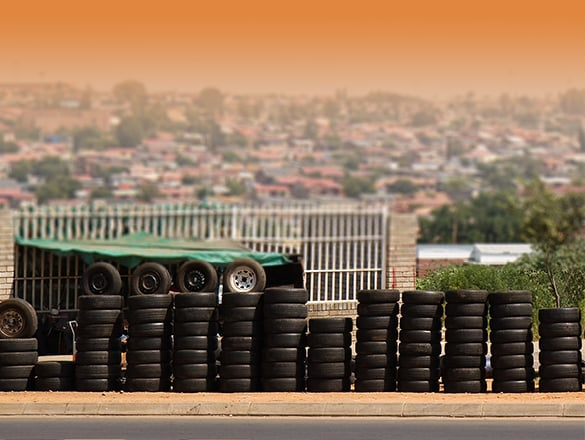 A line of used tyres in the market street of soweto