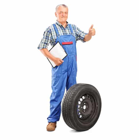 A worker and a checked tyre